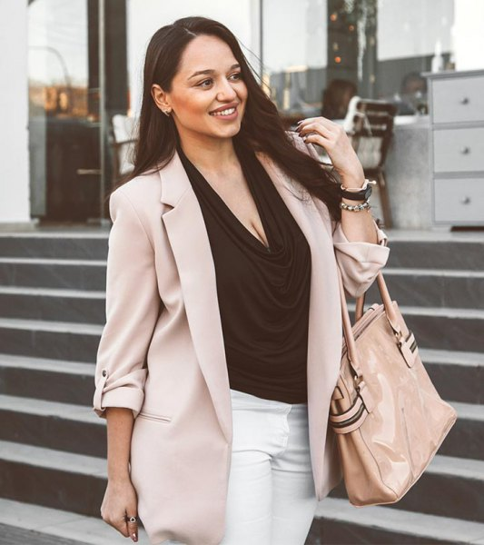 light grey khaki blazer with black cowl neck blouse and white jeans