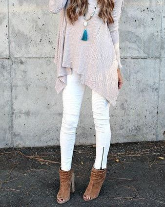light grey knit tunic top with white zip leg jeans