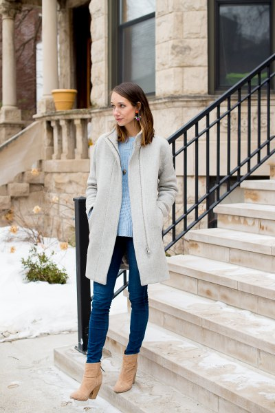 light grey long coat with sky blue sweater and skinny jeans