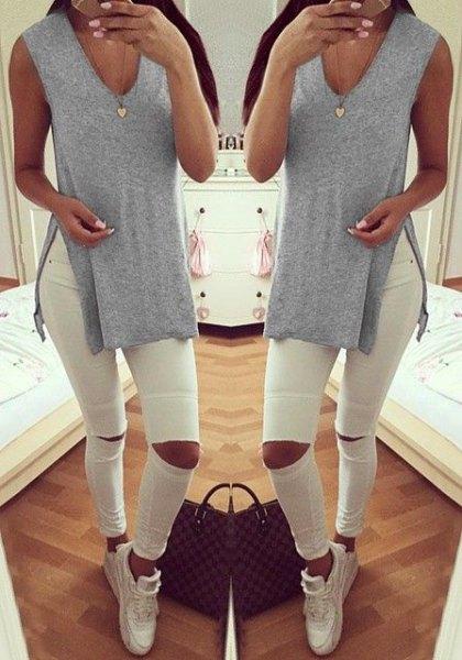 light grey v neck side slit shirt with white ripped jeans