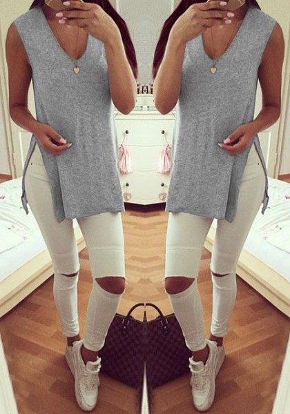 light grey v neck side slit shirt with white ripped jeans