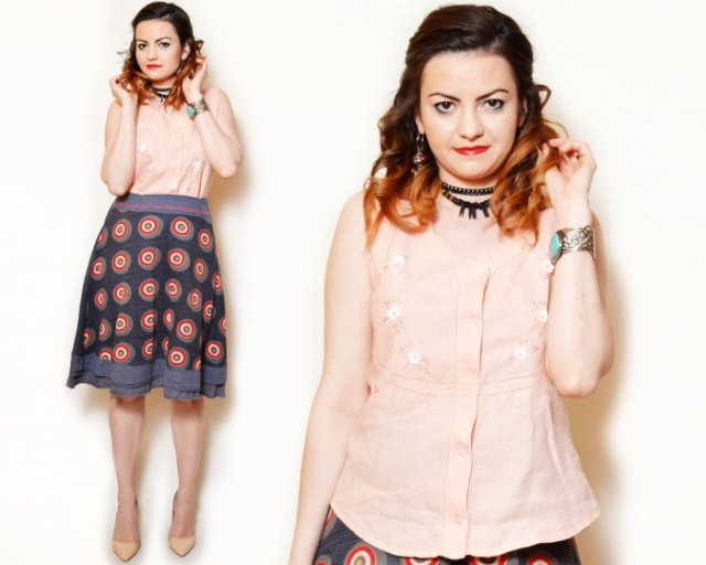 light peach floral embroidered sleeveless shirt with navy printed skirt