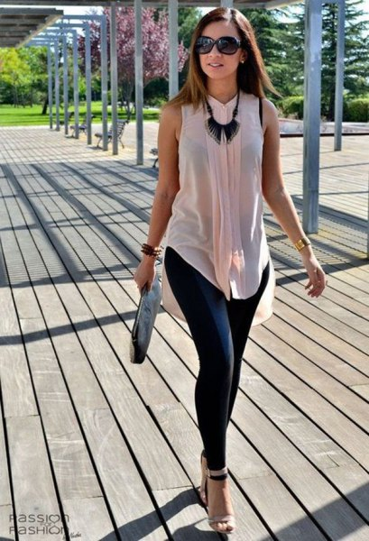 light pink semi sheer sleeveless chiffon shirt with black leggings
