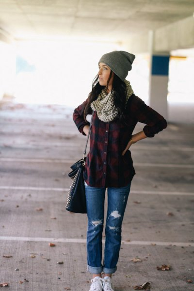 navy and dark green plaid shirt with blue ripped flannel lined jeans