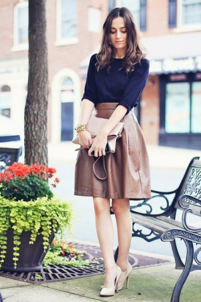 navy blue half sleeve sweater with brown high waisted leather midi flared skirt