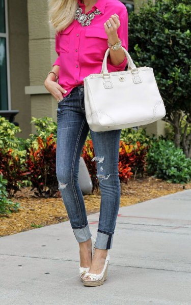 neon pink shirt with statement necklace and cuffed skinny jeans