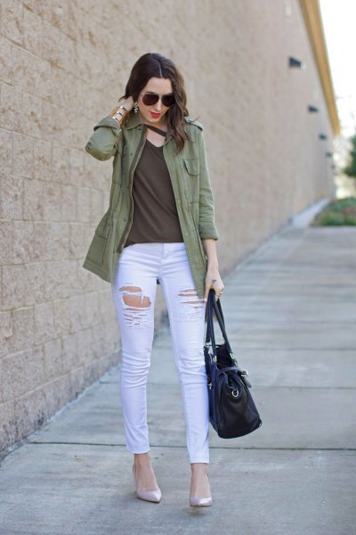 olive casual jacket with green v neck top and white skinny jeans