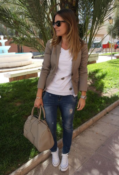 olive green khaki blazer with white sweater and blue jeans