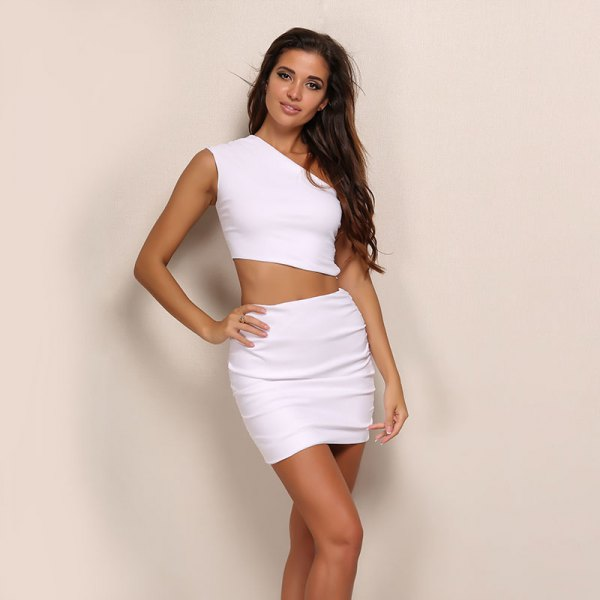 one shoulder crop top with white mini bodycon skirt