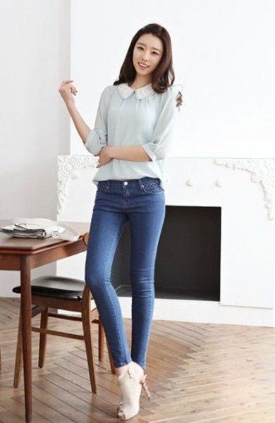 pale pink rounded collar blouse with blue jeans