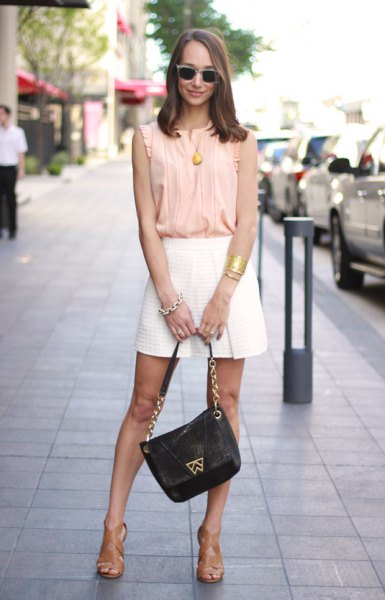 pale yellow sleeveless shirt with white flowy mini shorts