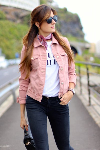 pink denim jacket with white print tee and light blue silk choker scarf