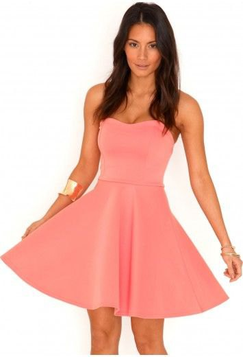 pink fit and flare strapless mini dress with gold cuff bracelet