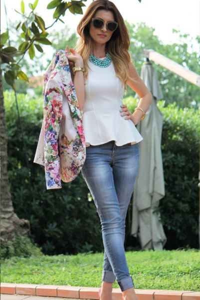 pink floral jacket with white peplum top and cuffed skinny jeans