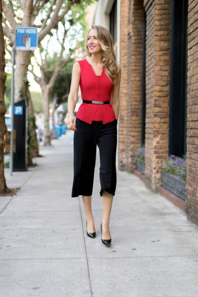 red sleeveless belted blouse with black cropped straight leg dress pants