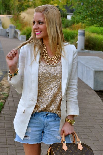 rose gold metallic blouse with white blazer and light blue denim shorts