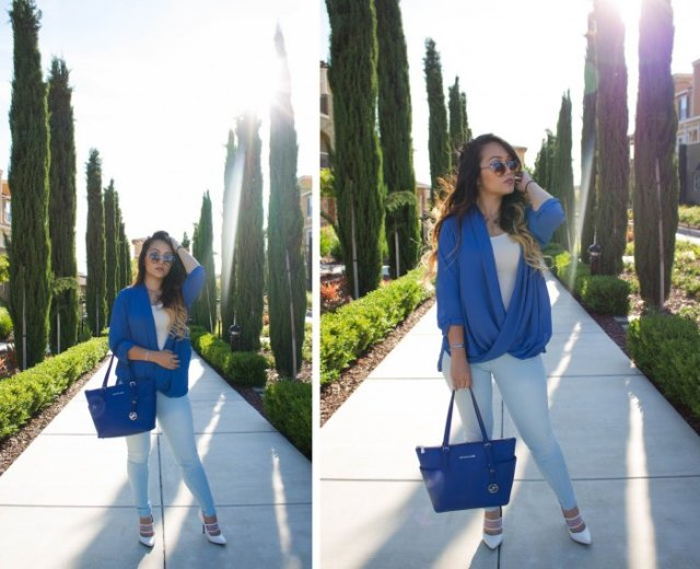 royal blue leather purse with matching draped top and white jeans