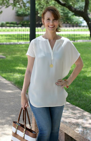 short sleeve white v neck blouse with blue jeans