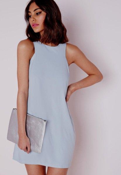 sky blue chiffon mini dress with silver matte clutch bag