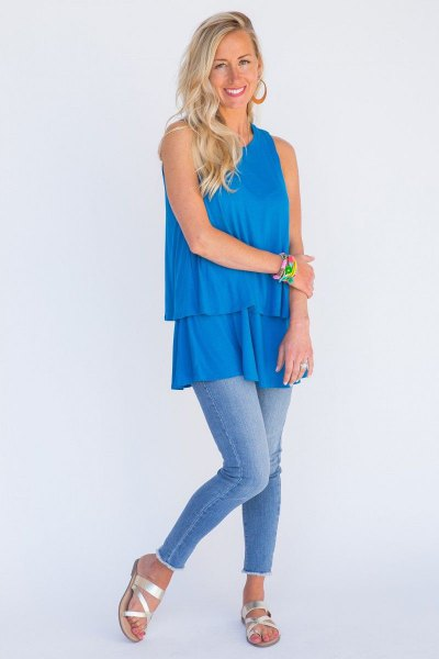 sky blue ruffle hem tunic top with skinny jeans