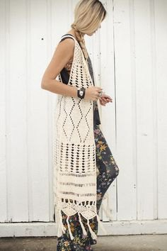 white crochet maxi length knit hippie vest with floral printed leggings