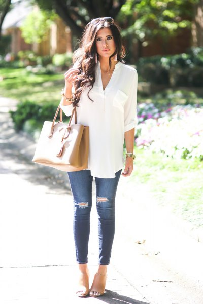 white dressy button up tunic top with blue ripped skinny jeans