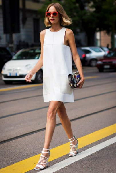 white mini sleeveless shift dress with matching open toe strappy heels
