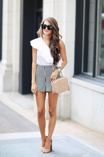 white one shoulder ruffle top with black striped flowy shorts