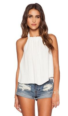 white pleated flowy tank top with denim mini shorts