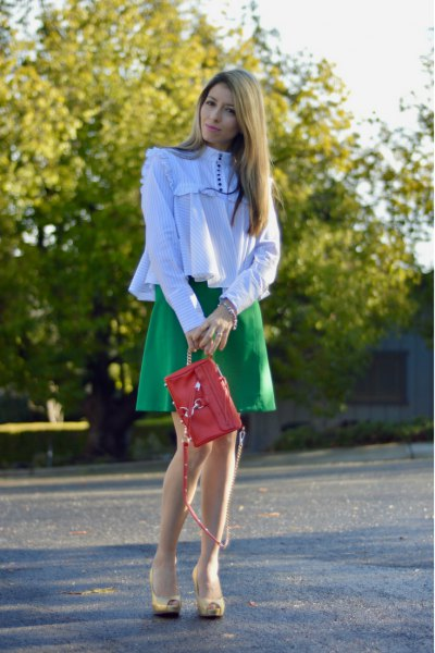 white ruffle long sleeve mock neck shirt with camel skater skirt