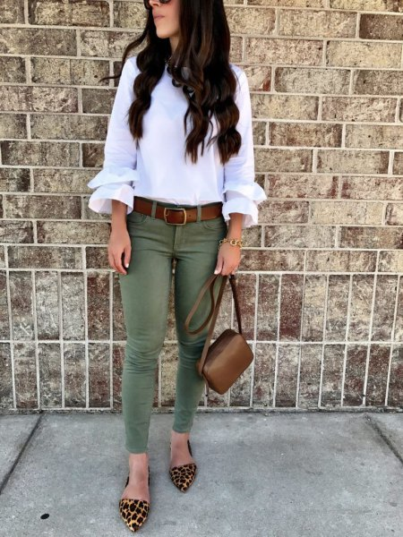 white ruffle sleeve blouse with olive skinny jeans