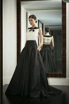white sleeveless chiffon blouse with black floor length skirt