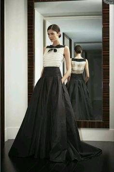 white sleeveless chiffon blouse with black floor length skirt