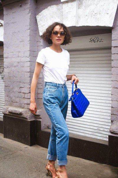 white tee with mom jeans and blue purse