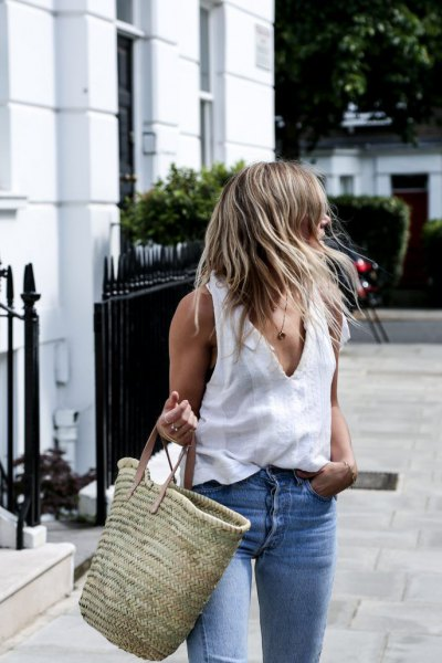 white v neck tank top with blue jeans and straw bag