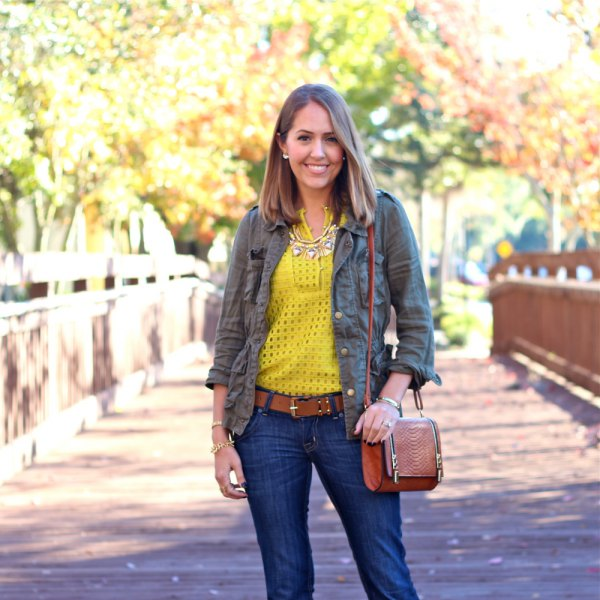 yellow cutout shirt with grey chambray shirt and dark jeans