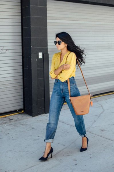 yellow shirt with cuffed washed mom jeans