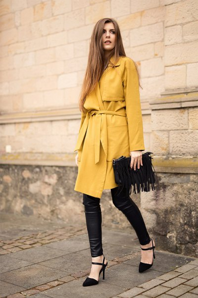 belted longline wool coat with black leather leggings