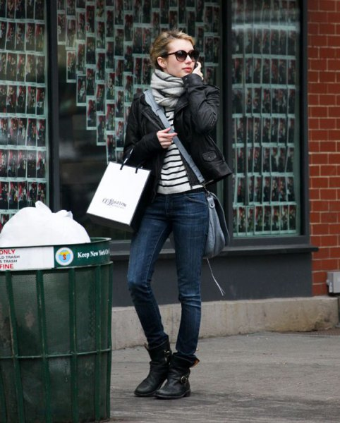 black and white striped tee with biker jacket and leather ankle motorcycle boots