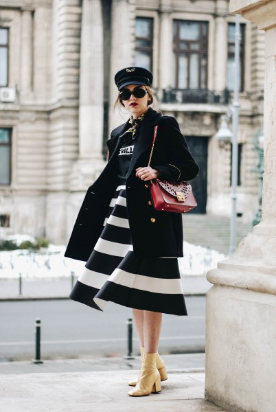 black and white wide striped midi flared dress with brown leather shoulder bag