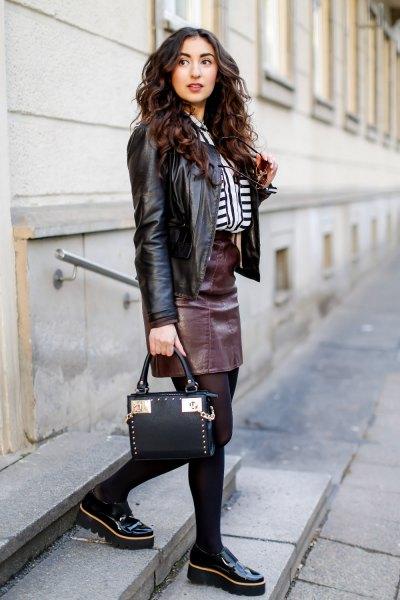 black biker jacket with leather skirt and platform loafers