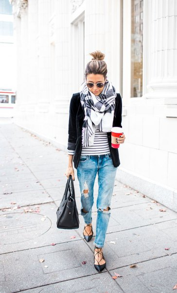 black blazer with striped tee and heavily ripped boyfriend jeans