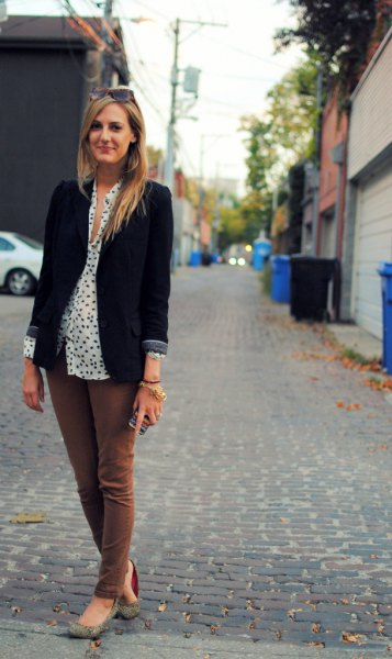 black blazer with white and black polka dot button up blouse