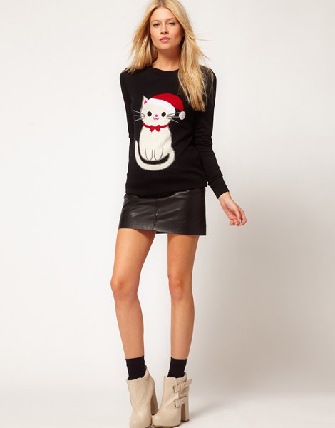 black cartoon cat printed sweater with mini leather skirt