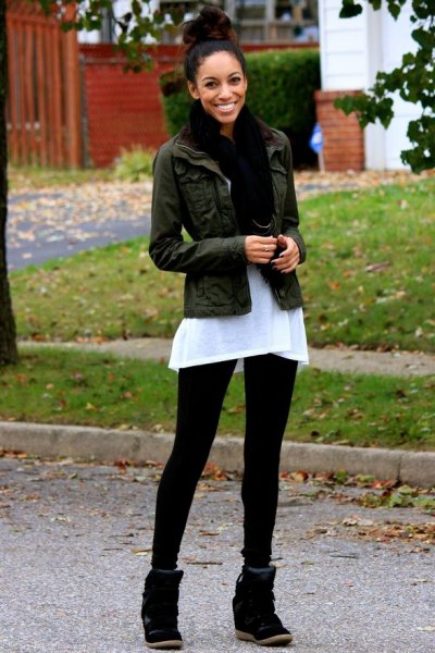 black denim jacket with white tunic top and wedge sneakers