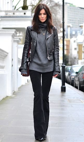 black fitted leather jacket with grey chunky sweater and flared velvet jeans