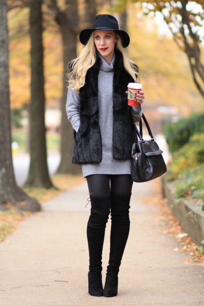 black floppy hat with grey cowl neck sweater dress and leggings