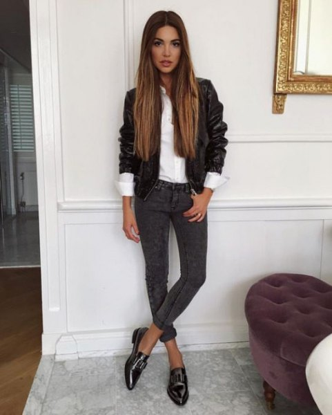 black leather jacket with white shirt and dark grey cuffed skinny jeans