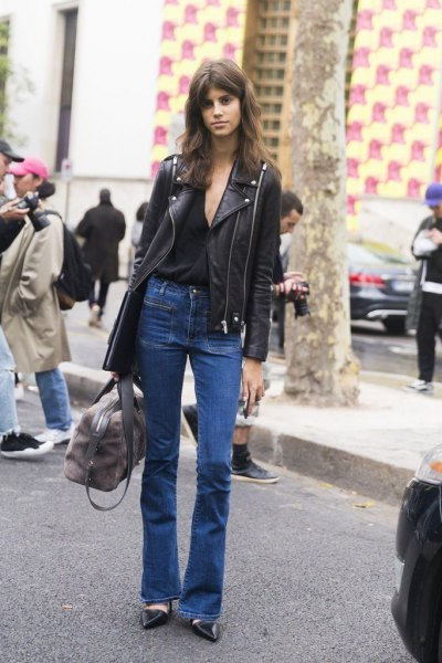 black leather moto jacket with blue high rise flared jeans