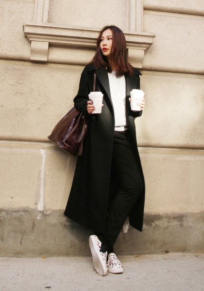 black longline blazer coat with white v neck sweater and canvas sneakers
